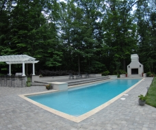 Geometric Pool with Outdoor Fireplace and Pergola